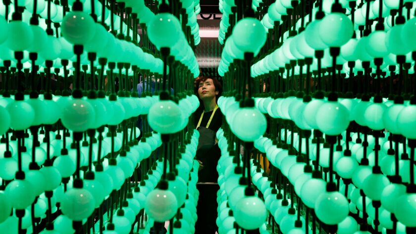 Soyoung Han looks at a display representing LG super UHD TV Nano Cell displays during CES Internatio