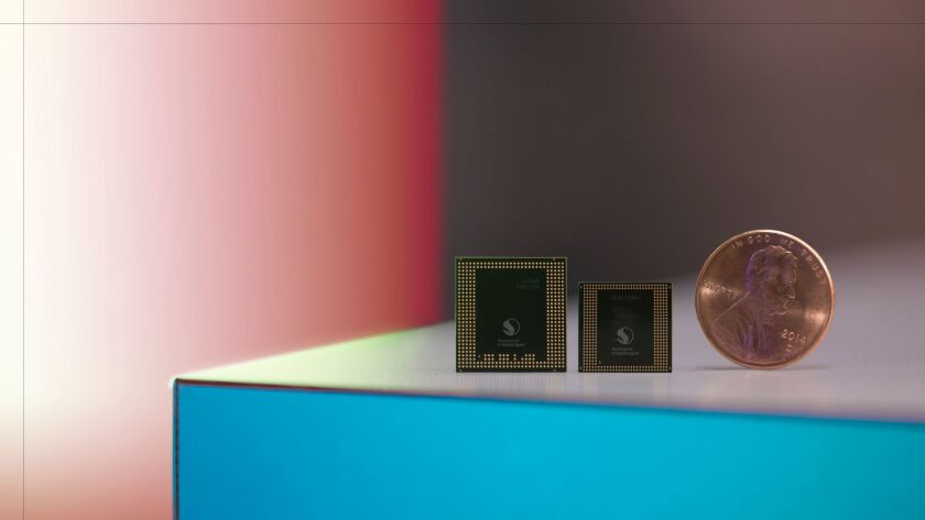 Qualcomm's latest Snapdragon 835 integrated apps processor,  right, contains a gigabit class LTE cellular modem.