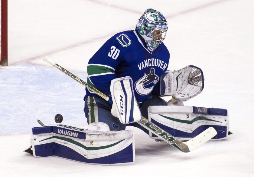 Vancouver Canucks goaltender Ryan Miller turns away an Anaheim Ducks shot during the second period of an NHL hockey game Thursday, Feb. 18, 2016, in Vancouver, British Columbia. (Ben Nelms/The Canadian Press via AP)