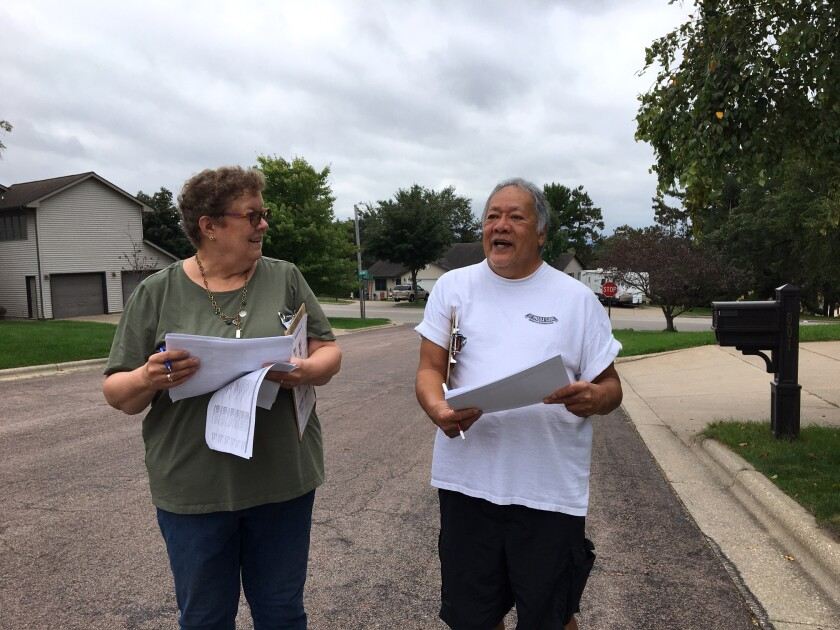 Democrats Carol Klitzke and Marlo Santillan canvass a neighborhood in Onalaska, Wis.