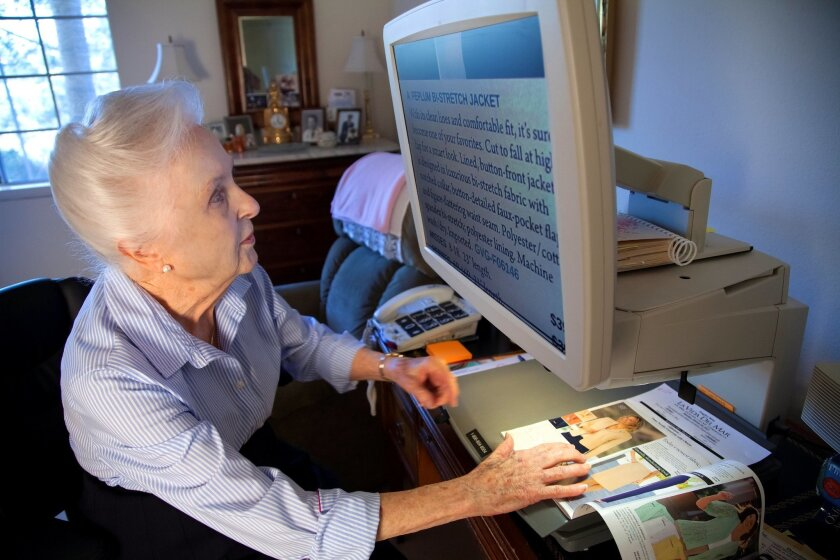 Marjorie Basnight was diagnosed with macular degenaration since 1990, however since 1999 it has worsened dramatically. To help read Basnight uses a Aladdin Apex machine to help magnify the words from pages of a magazine.
