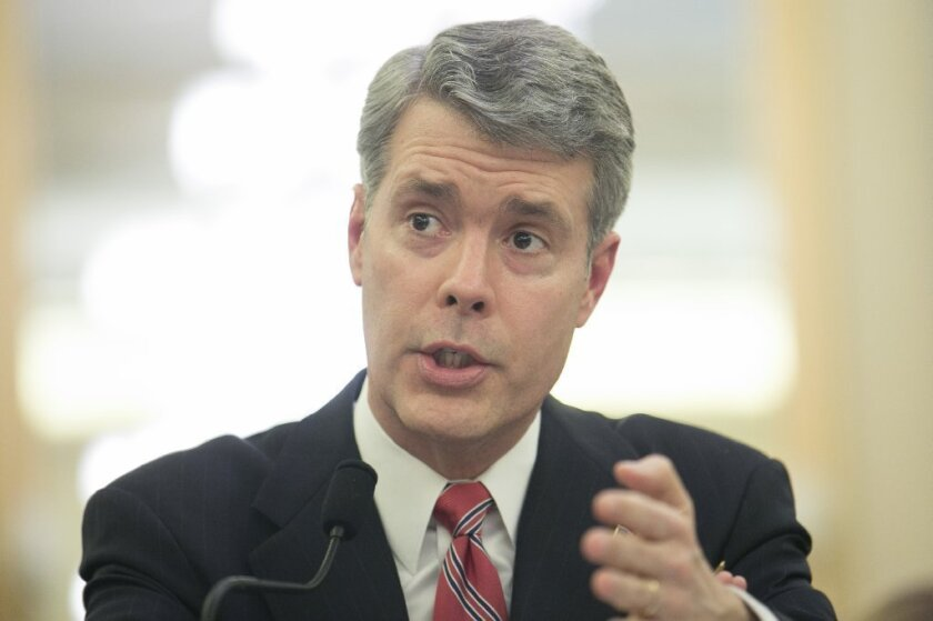 FCC Commissioner Robert McDowell exiting