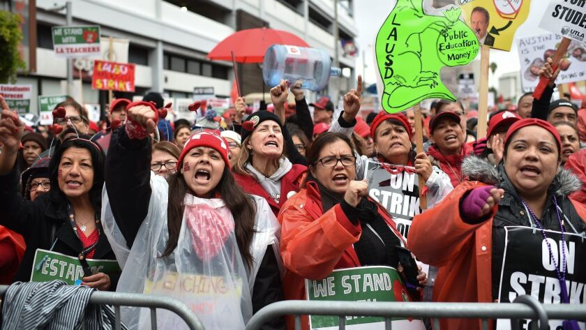 Striking teachers and their supporters march on the downtown L.A. headquarters of the California Charter Schools Assn. on Jan. 15, during the recent teachers strike. Union leaders have called for a moratorium on new charters.