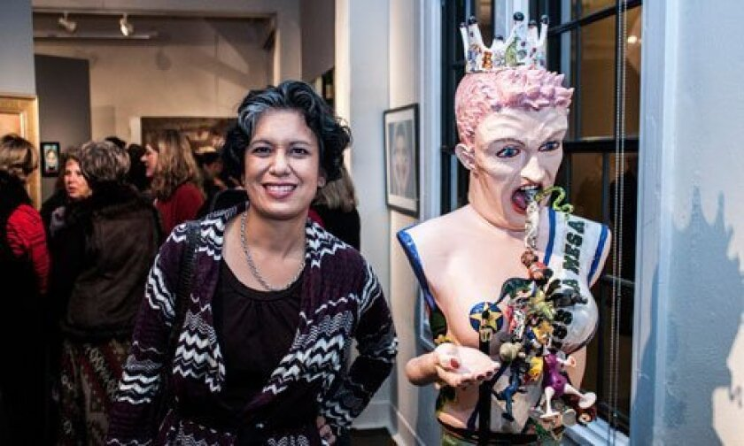 Mesa College Gallery Director Alessandra Moctezuma with the other second-prize winner, 'Miss La Mesa,' by Lee Puffer.