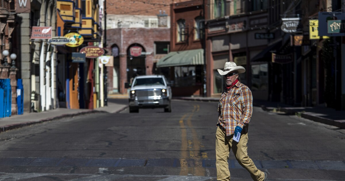 The 1918 flu hammered this Arizona mining town. Now a new scourge looms