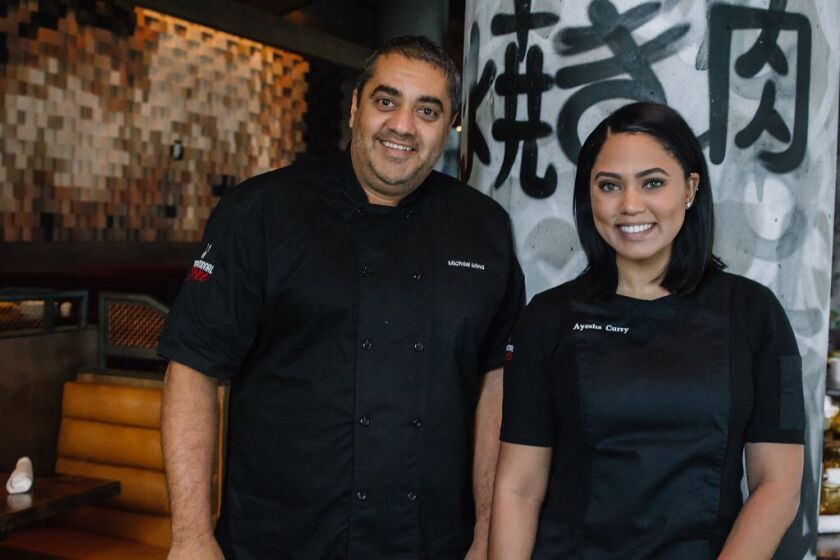 Michael Mina and Ayesha Curry are bringing their star power to San Diego with the opening of International Smoke at One Paseo.