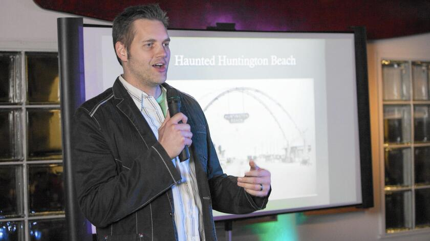 """SyFy channel host and paranormal investigator Ben Hansen speaks during """"Night at the Surfing Museum"""" on Wednesday at the International Surfing Museum in Huntington Beach."""
