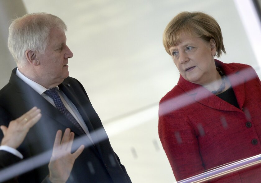 German Chancellor Angela Merkel, right, and the Governor of the German State of Bavaria, Horst Seehofer, left, arrive for a statement about migration  prior to a faction meeting  at the German federal parliament, Bundestag, in Berlin, Germany, Tuesday, Nov. 3, 2015. (AP Photo/Michael Sohn)