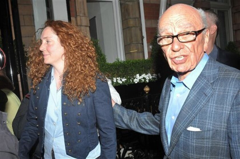 News International chief executive Rebekah Brooks, left, and Rupert Murdoch are seen outside the central London residence of News Corporation chairman Rupert Murdoch, Sunday July 10, 2011. News Corp title News of the World newspaper ceased publication with today's issue, following accusations of alleged hacking into the mobile phones of various crime victims, celebrities and politicians. (AP Photo/Ian Nicholson, PA) UNITED KINGDOM OUT - NO SALES - NO ARCHIVES