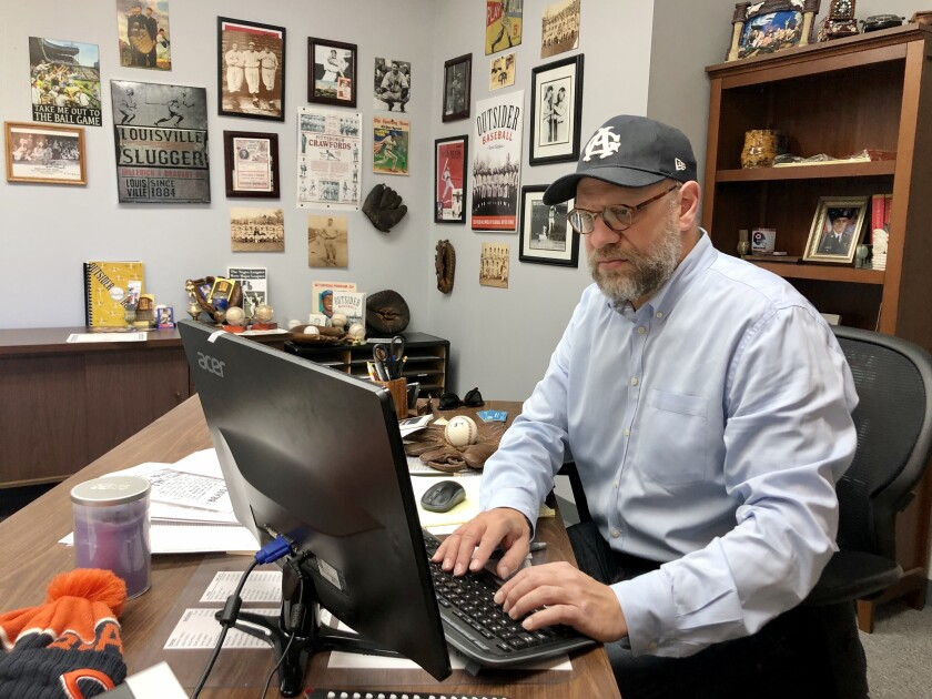 Negro Leagues historian Scott Simkus, working in his Chicago office.