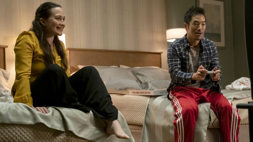 "Lily Gladstone and Leonardo Nam in ""Room 104"" on HBO."