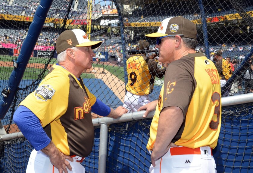 Jul 11, 2016; San Diego, CA, USA; National League coach Terry Collins (left) talks with American League coach Ned Yost (right) during workout day before the MLB All Star Game at PetCo Park. Mandatory Credit: Kirby Lee-USA TODAY Sports ** Usable by SD ONLY **