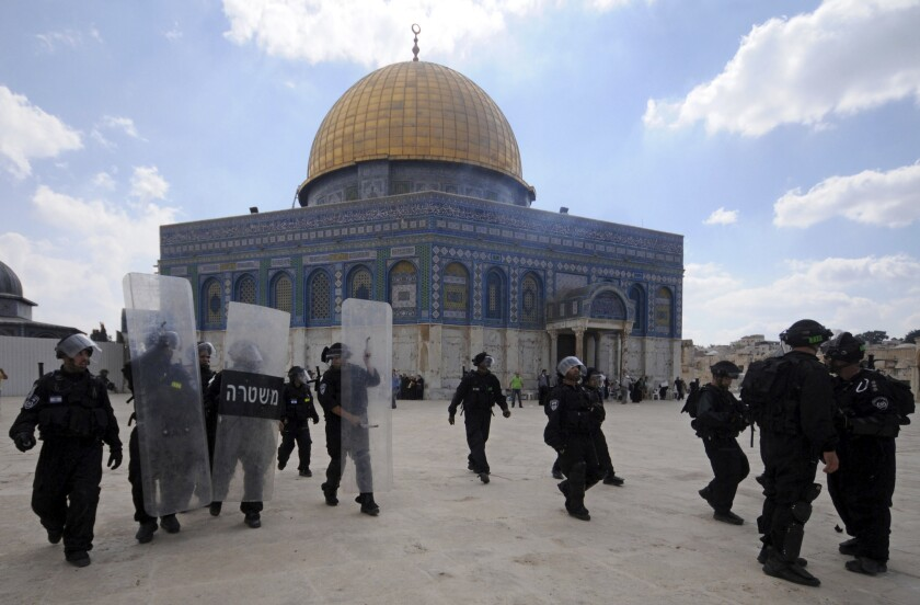 In this Oct. 5, 2012, file photo, Israeli forces take position during clashes with Palestinian worshippers at the Al Aqsa Mosque compound in Jerusalem's Old City.