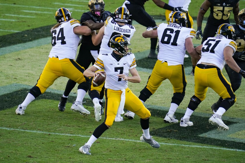 Iowa quarterback Spencer Petras (7) looks to throw against Purdue during the second quarter of an NCAA college football game in West Lafayette, Ind., Saturday, Oct. 24, 2020. (AP Photo/Michael Conroy)