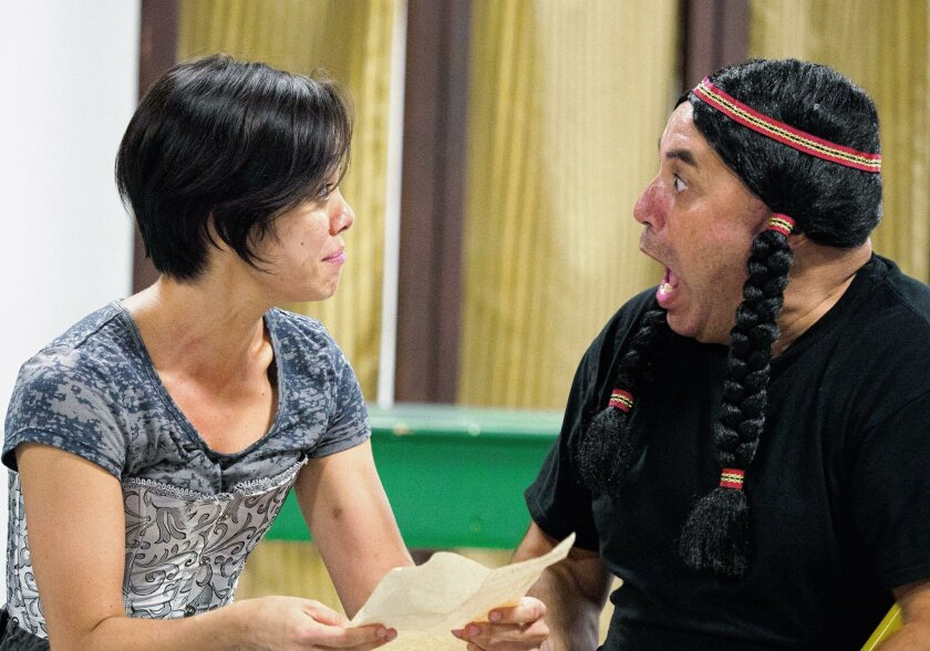 """Jennifer Paredes and Herbert Siguenza in rehearsal for the San Diego Rep production of Siguenza's """"Manifest Destinitis."""""""