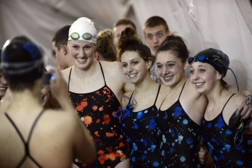 Olympic gold medalist and Regis Jesuit High School swimmer Missy Franklin, left, poses with Highlands Ranch High School swimmers after a meet.
