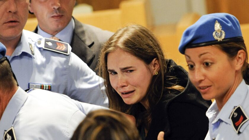Amanda Knox cries following the verdict that overturns her conviction and acquits her of murdering h