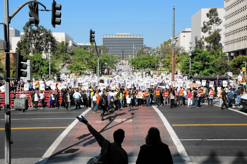 Members of the Coalition of L.A. City Unions rally in front of City Hall in October.