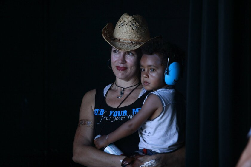 Danielle LoPresti holds her son, Lucian, backstage at IndieFest.