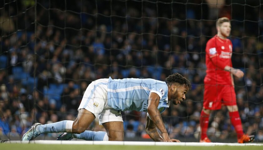 Manchester City's Raheem Sterling gets up from the back of the net after falling over attempting a shot on goal during the English Premier League soccer match between Manchester City and Liverpool at the Etihad Stadium, Manchester, England, Saturday, Nov. 21, 2015.Liverpool won the game 4-1. (AP Photo/Jon Super)