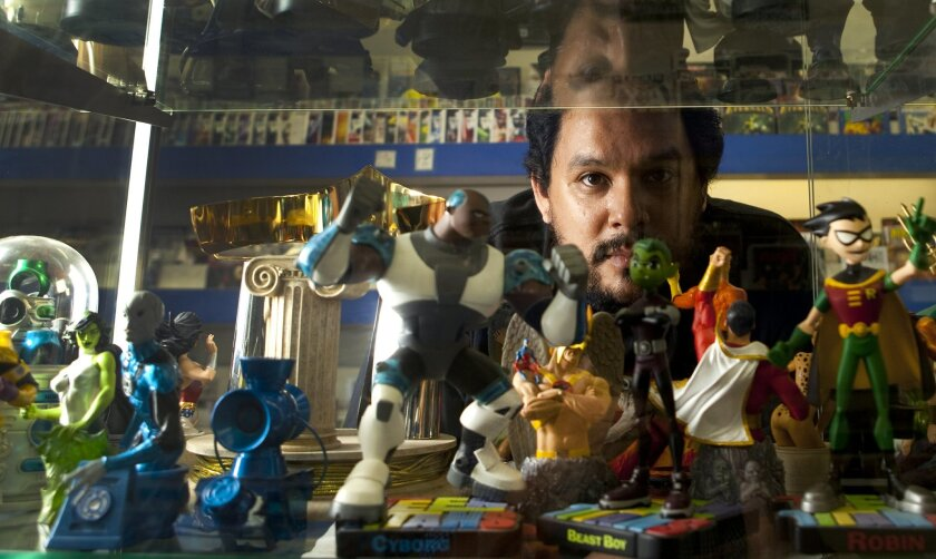 """Mike Marte, a self-described """"fanboy,"""" recently opened Superheroes In Training comic book shop in Escondido."""
