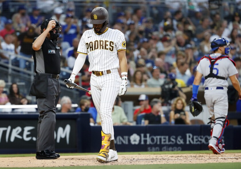 Padres' Fernando Tatis Jr. walks off after striking out against the Los Angeles Dodgers at Petco Park on Thursday.