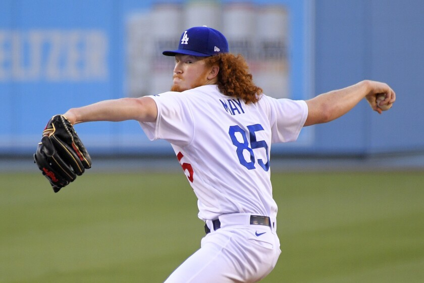 Dodgers starting pitcher Dustin May throws to the plate.