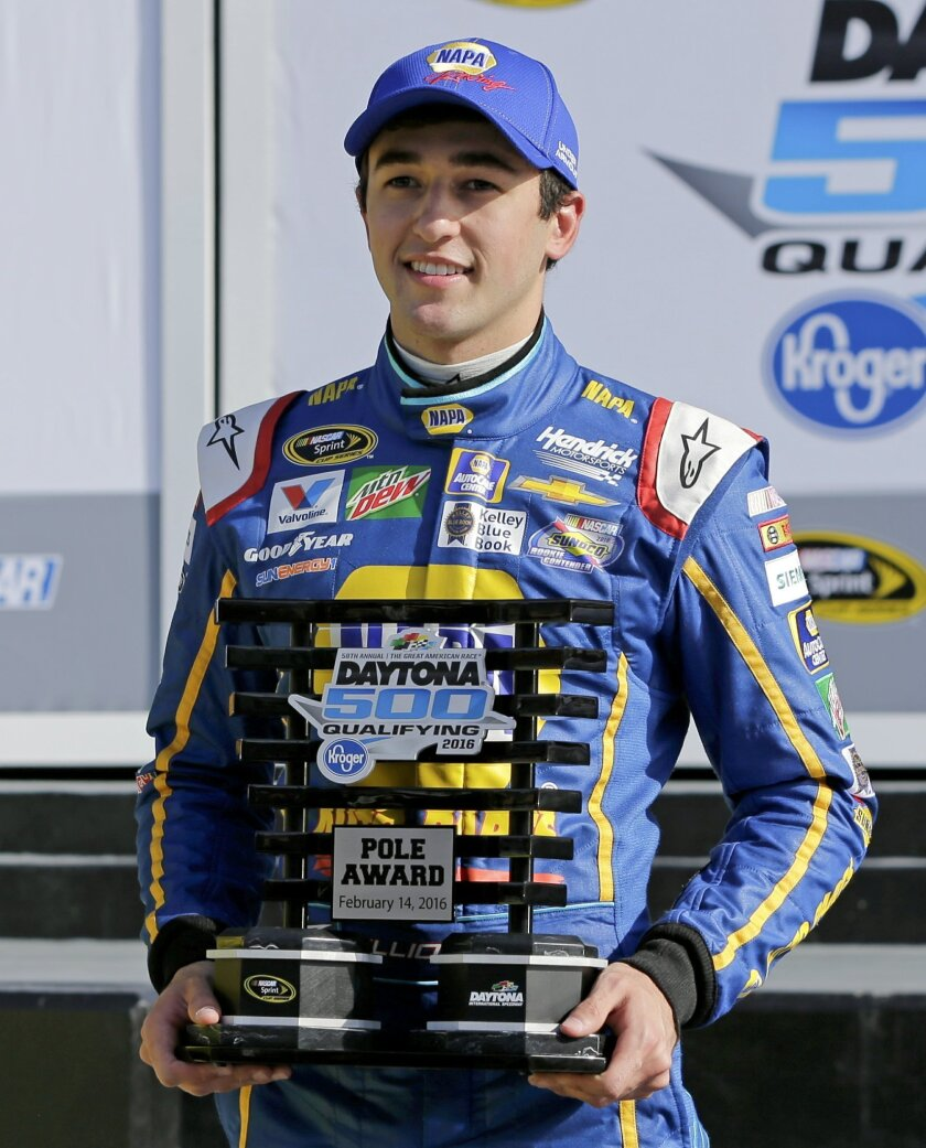 Chase Elliott holds the pole award trophy after he qualified for top position in the NASCAR Daytona 500 auto race at Daytona International Speedway, Sunday, Feb. 14, 2016, in Daytona Beach, Fla. (AP Photo/Terry Renna)