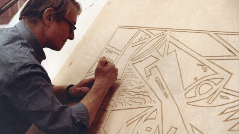 """Roy Lichtenstein carving into a wood block for """"Head,"""" 1980."""