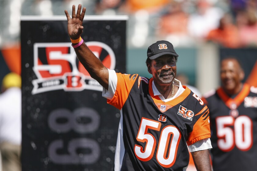 Former Cincinnati Bengals cornerback Ken Riley waves to the crowd during an on-field ceremony.