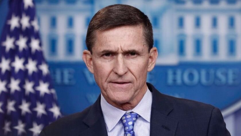 In this Feb. 1, 2017, photo, then - National Security Adviser Michael Flynn speaks during the daily