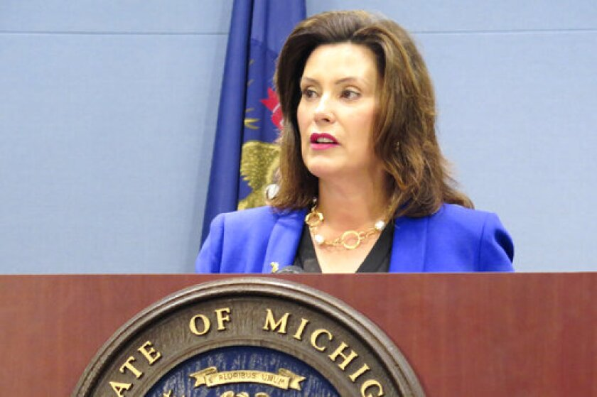 FILE - In this Aug. 28, 2019 file photo, Michigan Gov. Gretchen Whitmer speaks at a news conference in Lansing, Mich. Whitmer has signed changes to Michigan's reporting requirements for people who will have to meet work-related requirements to qualify for Medicaid coverage. But she's criticizing the Republican-led Legislature for not allocating $10 million to implement the rules. Whitmer on Monday, Sept. 23, 2019, signed a law exempting some enrollees in the state's Medicaid expansion program from meeting monthly reporting rules if the state can verify their compliance with work requirements through other data.(AP Photo/David Eggert File)