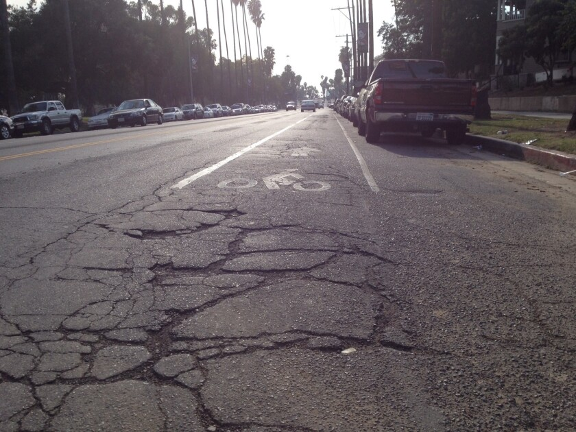Part of the bike lane along the downtown-bound side of Mission Road in Lincoln Heights is seen last Saturday.