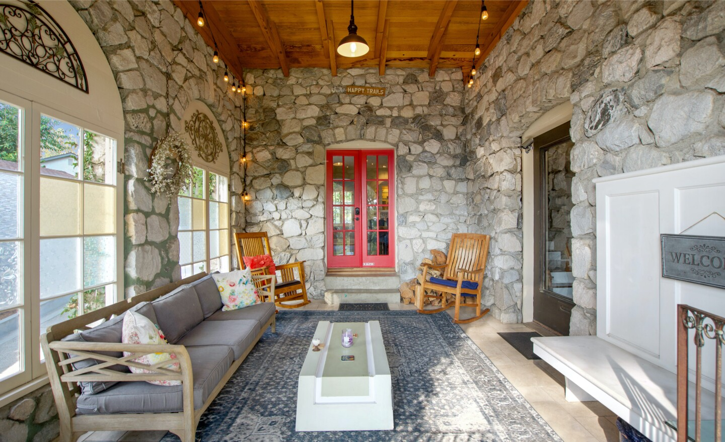 Built in 1936 from locally quarried stone, the charming stone-clad home holds four bedrooms and five bathrooms in 2,800 square feet.