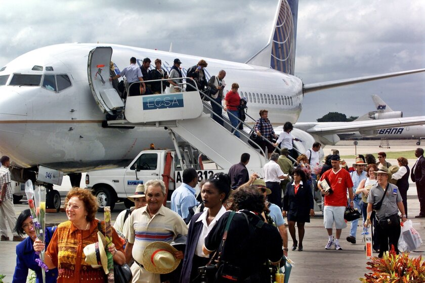 The first passengers of the first flight of Continental Airlines from Miami arrives at the Jose Marti Airport of Havana on Nov. 1, 2001. The United States and Cuba have reached an understanding on restoring regularly scheduled commercial flights.