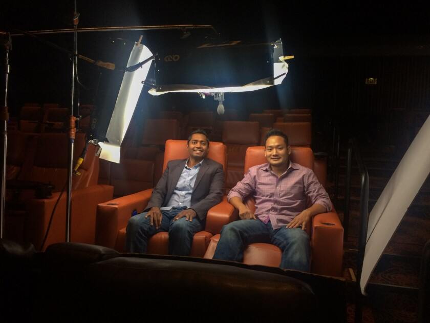 Dealflicks CEO and Co-founder Sean Wycliffe, left, with head of business development Kevin Hong.