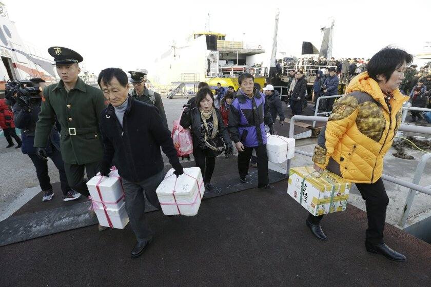 People and soldiers arrive from Baengnyeong island, at Incheon port, South Korea, Saturday, Feb. 20, 2016. Sounds of explosions caused South Korean residents of a front-line island to prepare to evacuate early Saturday, but it was later determined the noise came from a North Korean artillery drill