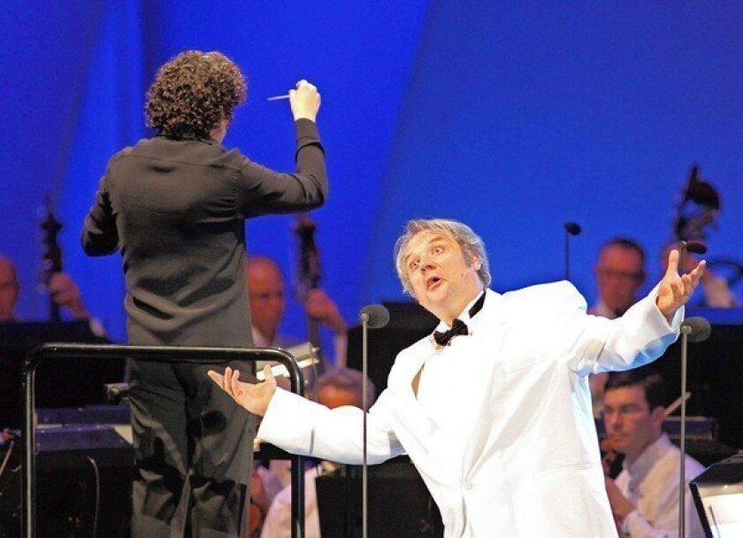 "Conductor Gustavo Dudamel, left, and baritone Zeljko Lucic interpret Verdi's popular opera ""Rigoletto"" at the Hollywood Bowl."