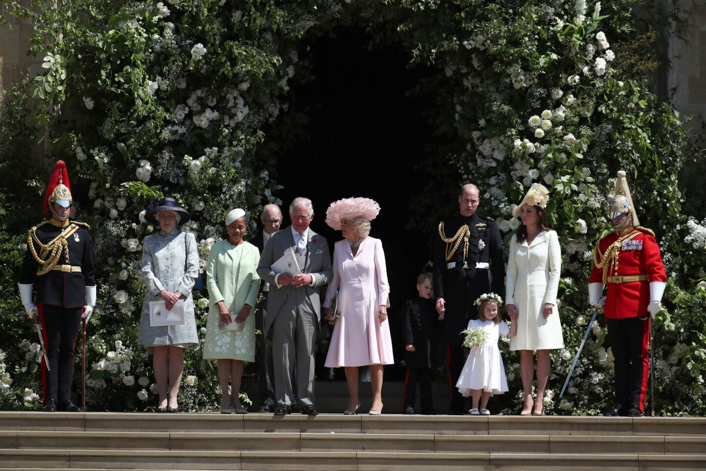 After the ceremony outside Windsor Castle, from left, Lady Jane Fellowes, sister of Princess Diana; Doria Ragland, mother of the bride; Prince Charles, Prince of Wales, and Camilla, Duchess of Cornwall; Prince William, Duke of Cambridge, and Catherine, Duchess of Cambridge with Prince George and Princess Charlotte.