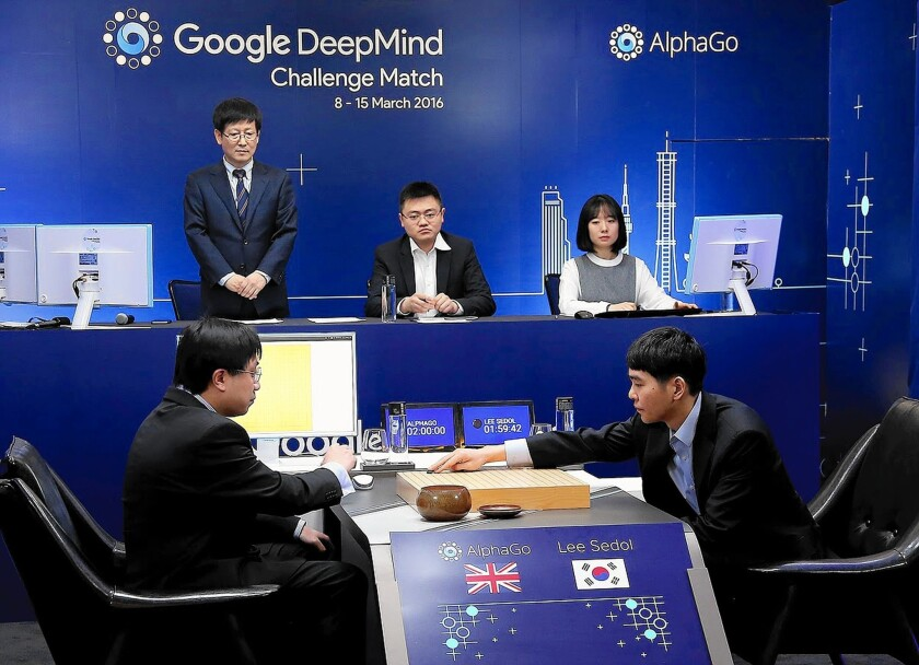 Lee Se-Dol, right, a legendary South Korean player of Go — an ancient board game developed in China that is more complex than chess — makes a move during the Google DeepMind Challenge Match in Seoul.