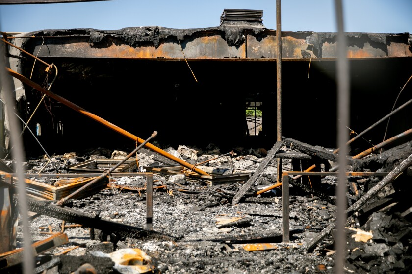 A building at the corner of Dalbergia and Thor streets is burnt out inside on July 2, 2020 in San Diego, California.