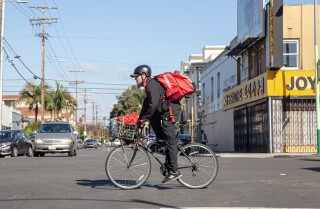 LOS ANGELES, CA- March 24, 2020: Bicycle delivery driver Justin Zemlyansky can deliver up to 30 meals in a shift, but said the coronavirus pandemic has reduced it to 10-12 per shift. (Cody Long / Los Angeles Times)