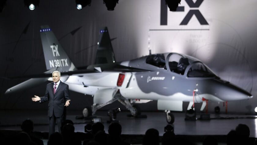 Darryl Davis, president of Boeing Phantom Works, reveals Boeing's proposed T-X Trainer aircraft in 2016.