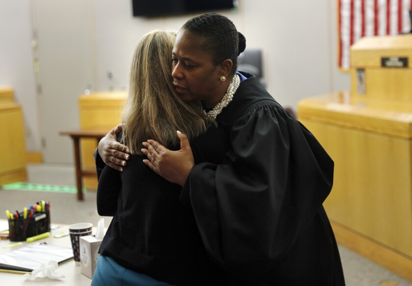 State District Judge Tammy Kemp gives former Dallas police officer Amber Guyger a hug before Guyger leaves for jail, on Wednesday in Dallas.