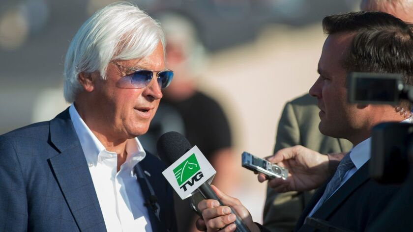 In a photo provided by Benoit Photo, trainer Bob Baffert is interviewed after Arrogate finished four