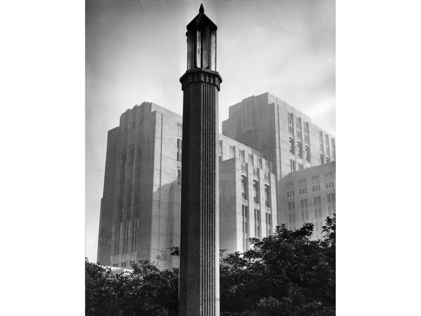 A street lamp dominates the foreground of this November 1955 photo of Los Angeles County General Hospital.
