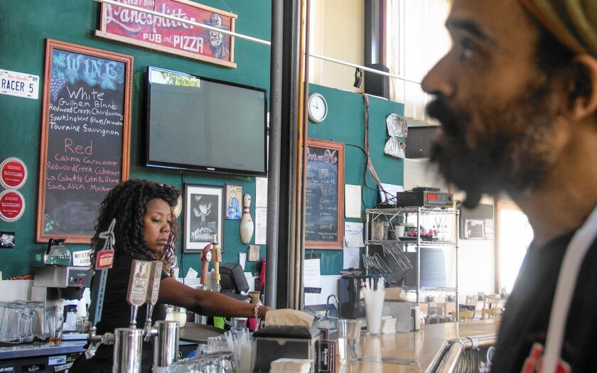 """Nina Gates, 44, and Ira Gibson, 39, are employees of Lanesplitter Pizza & Pub in Emeryville, Calif., whose workers earn $15 to $25 an hour as part of a business model that also did away with gratuities and raised prices, making meals at all five locations """"sustainably served … no tips necessary."""""""