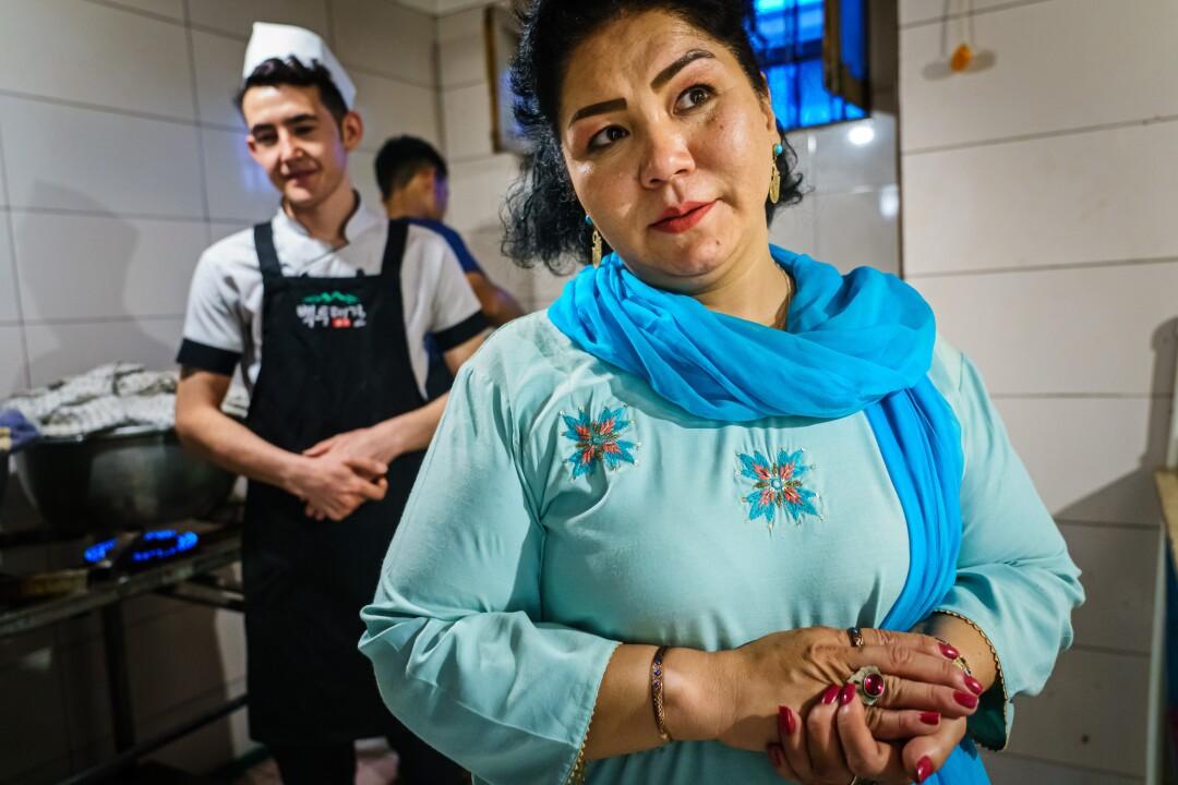 Laila Haidari with staff members of her cafe