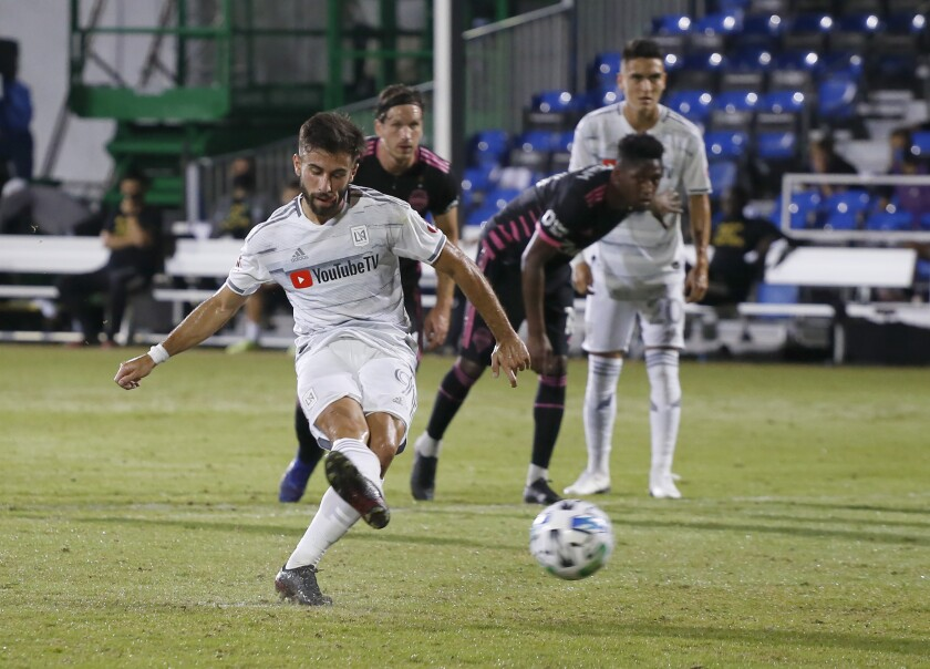 LAFC forward Diego Rossi takes a penalty kick, and scores, against the Seattle Sounders in Kissimmee, Fla., on Monday.