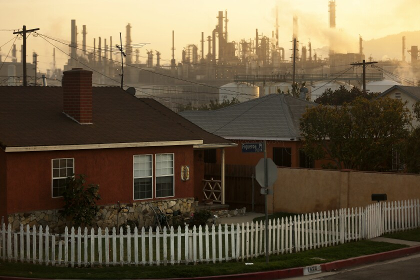 WILMINGTON, CA -- TUESDAY, MARCH 1, 2016 -- The Phillips 66 refinery looms over a Wilmington neighborhood where some long-time residents feel their health issues might stem from their proximity to the refinery. The Union Oil Company of California built the original refinery in 1919 between the old Anaheim road and the port, years before homes were constructed to form the neighborhood. ( Rick Loomis / Los Angeles Times )